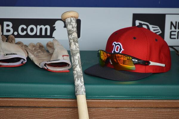 A player's hat, gloves, and bat lay on the bench before the Red Sox-Rangers game on June 25, 2016. (Source: I Am Second)