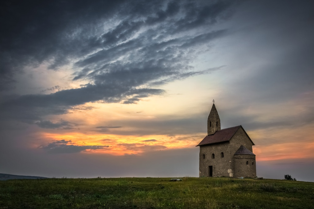 Old Roman Catholic Church of St. Michael the Archangel at Sunset in Drazovce, Slovakia. (Source: Dollar Photo Club)