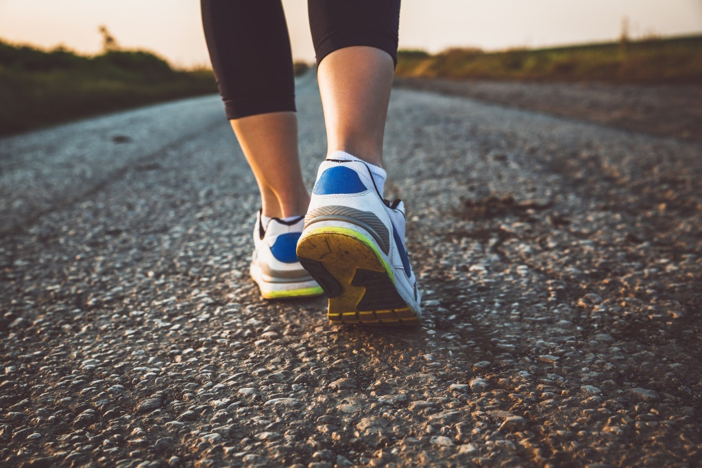 Woman's athletic legs .Close up image of sneakers.Jogging.