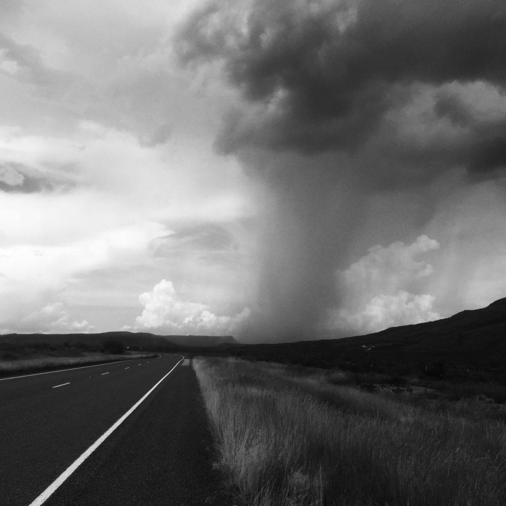 A rain cloud passing ahead of us on our trip. (Photo source: Jonathon M. Seidl)