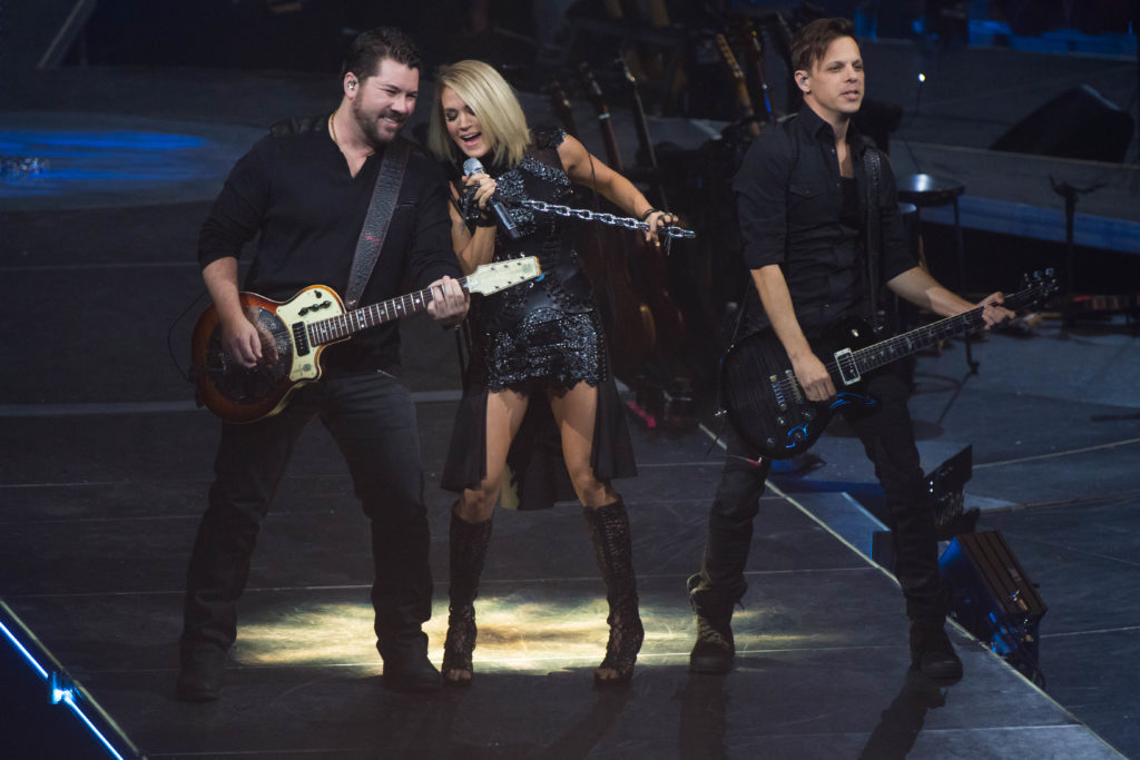 Ed Eason (right) performing with Carrie Underwood during the Storyteller Tour (Photo source: Dan Harper)
